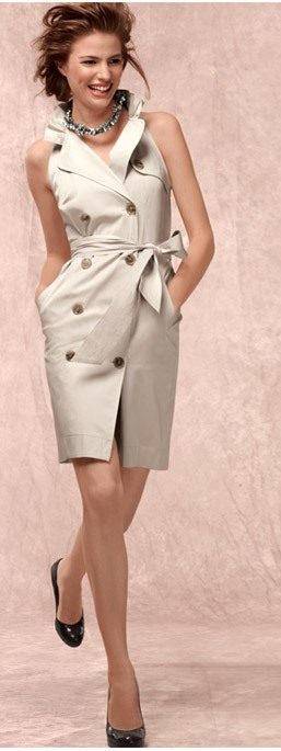 1e2cec23cb79 Sleeveless trench dress in cotton with a hint of stretch. Ruffle neckline.  Notch lapels. Double-breasted button front. Removable self-tie at waist.