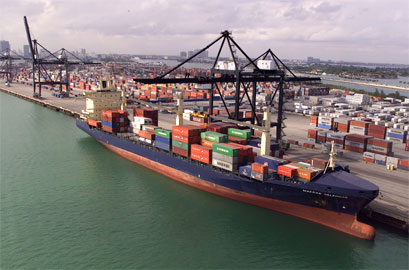 A container ship docks at the Miami seaport. Apparel Search Directory of ocean freight